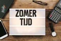 Zomertijd, Dutch Daylight Saving Time in vintage style light box Royalty Free Stock Photo