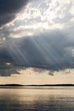 Zon achter wolken Stock Fotografie