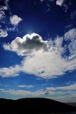 Zon achter wolken Stock Foto's