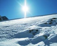 Zon en sneeuw Stock Foto's