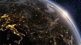 Zona de Europa de la tierra del planeta con noche y salida del sol Imagen de archivo libre de regalías