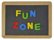 Zona de la diversión en letras coloreadas en pizarra Fotos de archivo