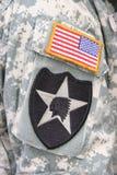Zona indiana della bandierina e della testa sull'uniforme del soldato dell'esercito fotografie stock