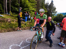 Zoncolan. Dutch cyclist Jos van Emden gets a push of a spectator on the climb of the Monte Zoncolan during the 2014 Giro d'Italia Stock Photography