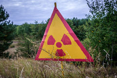 Zone of Alienation. Close up on radiation sign in Red Forest near power plant in Chernobyl Exclusion Zone, Ukraine Royalty Free Stock Image