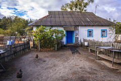 Zone of Alienation. House in Kupovate settlement of so called Samosely - residents of Chernobyl Exclusion Zone, Ukraine Royalty Free Stock Photo