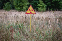Zone of Alienation. Radiation sign in Red Forest near power plant in Chernobyl Exclusion Zone, Ukraine Royalty Free Stock Photography