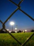 Zone de base-ball sous des lumières Images libres de droits