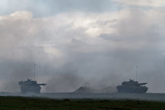 Zone de guerre avec des réservoirs Images libres de droits