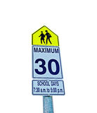 Zone 30km/hr sign school time. Zone 30km/hr sign for school time Royalty Free Stock Photography