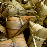 Zongzi. Tranditional Chinese rice-pudding, wrapped in bamboo leaves Royalty Free Stock Image