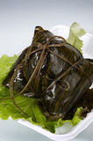 Zongzi feature close-up. Food rice dumplings, white background Royalty Free Stock Image