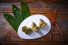 Zongzi Glutinous sticky Rice Dumplings recipe. Wrap with bamboo leaves asian food Stock Image