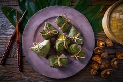Zongzi Glutinous sticky Rice Dumplings recipe. Wrap with bamboo leaves asian food Stock Photo
