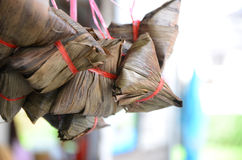 Zongzi. Pyramid-shaped dumplings made by wrapping glutinous rice in bamboo leaves Stock Images