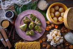 Zongzi Rice Dumplings pork buns shiitake noodles. Sesame asian food mix Royalty Free Stock Photos
