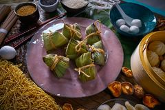 Zongzi Rice Dumplings pork buns shiitake noodles. Sesame asian food mix Stock Photo