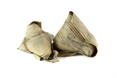ZongZi. Is a traditional Chinese food, made of glutinous rice stuffed with different fillings and wrapped in bamboo, reed, or other large flat leaves. They are Royalty Free Stock Photo