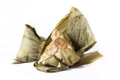 ZongZi. Is a traditional Chinese food, made of glutinous rice stuffed with different fillings and wrapped in bamboo, reed, or other large flat leaves. They are Stock Photo