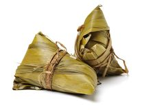 Zongzi; traditional Chinese rice-pudding eaten during dragon boat festival. Isolated on white background stock photo