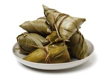 Zongzi; traditional Chinese rice-pudding eaten during dragon boat festival. Isolated on a white background stock images