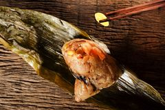 Zongzi or Traditional Chinese Sticky Rice Dumplings. Royalty Free Stock Images