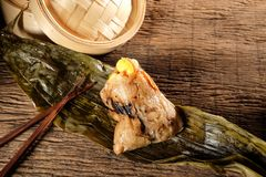 Zongzi or Traditional Chinese Sticky Rice Dumplings. Stock Photo