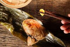 Zongzi or Traditional Chinese Sticky Rice Dumplings. Royalty Free Stock Photo