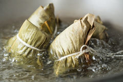 Zongzi in a wok Stock Photo
