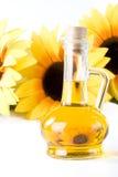 Zonnebloem en plantaardige olie Stock Foto's
