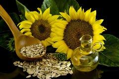 Zonnebloem met olie Stock Afbeeldingen