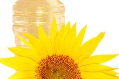 Zonnebloemen en olie Stock Foto's
