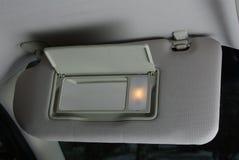 Zonneklep in een auto stock foto