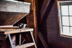 Zonneschijn die door een Venster komen die op een Lepel in DE Zwaan Windmill glanzen royalty-vrije stock afbeeldingen