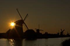 Zonnestralen en windmolens Stock Fotografie