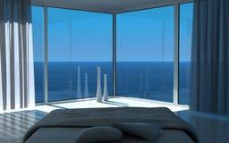 Zonnig slaapkamerbinnenland met zeegezichtmening Royalty-vrije Stock Foto