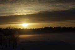 Zonnige zonsondergang Stock Afbeeldingen