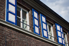ZONS, GERMANY - SEPTEMBER 25, 2016: Nicely painted windows contrast with the bricks Stock Photos