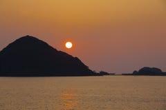 Zonsondergang in baai Stock Foto