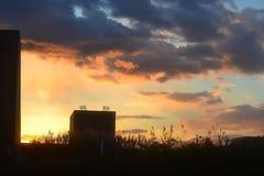 Zonsondergang bij aankoop stock foto