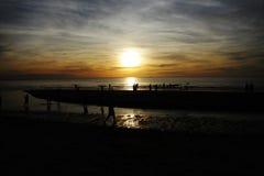 Zonsondergang bij Chaam-strand Stock Foto