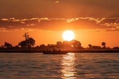 Zonsondergang bij de Chobe-Rivier stock afbeelding