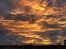 Zonsondergang bij de kust stock fotografie