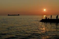 Zonsondergang bij de kust Stock Afbeelding