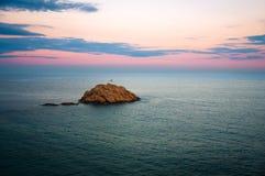 Zonsondergang bij de kust van Tossa de Mar, Costa Brava, Spanje Stock Fotografie