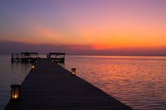 Zonsondergang bij de pier Stock Fotografie