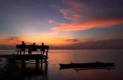 Zonsondergang bij de pier stock foto's