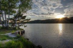Zonsondergang bij een meer Stock Fotografie