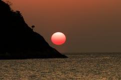 Zonsondergang bij eiland Stock Foto's