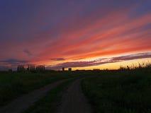 Zonsondergang bij het gebied Stock Foto